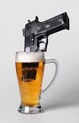 gun in a beer glass