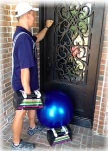 """personal trainer knocking on door of home in Double Oak"""" vspace="""
