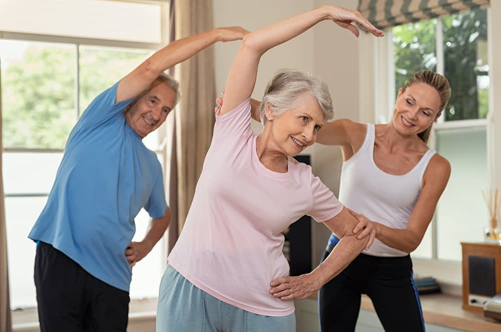 senior personal training client with coach