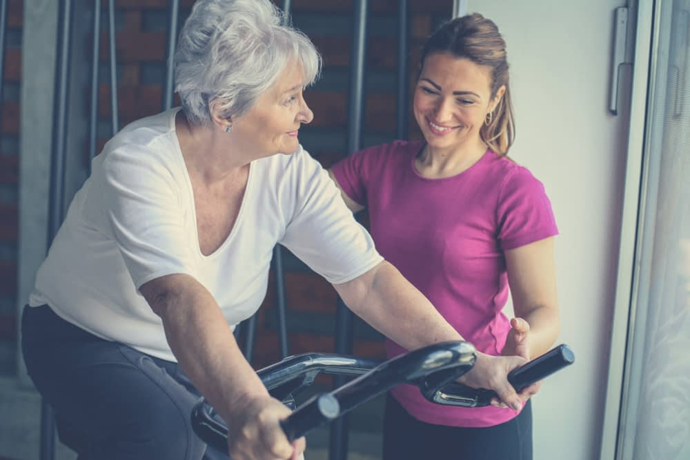 older female client with woman personal trainer