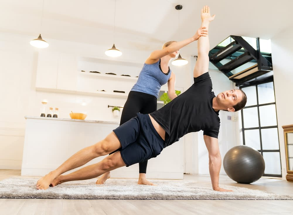 male client with female in home personal trainer